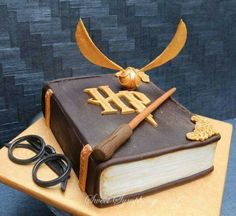 I really get nervous when I have to make any kiddy themed cakes and when I was asked to make a Harry Potter themed cake with minimum Fondant ,I was in a fix .To get a clean finish to look like a book with very little fondant was a challenge but I. Bolo Harry Potter, Gateau Harry Potter, Harry Potter Birthday Cake, Harry Potter Food, Harry Potter Theme, Harry Potter Book Cake, Harry Potter Glasses, Harry Potter Enfants, Cupcakes Decorados
