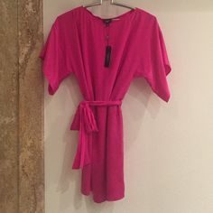 New with tag Fuschia Dress Talbot Kimono style Fuschia dress 6p. Small stain in back...as seen in picture. Talbots Dresses Midi
