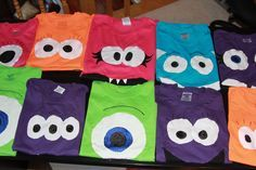 I made Monster shirts for all the kids coming to Beth's 7th birthday party tomorrow (theme is Monsters Inc). These are just a few of them. All are different. I bought t-shirts at JoAnn's, sewed on fabric eyes (and on some, mouths). The eyeballs, lashes, teeth, etc. are fabric paint. This has been too much fun!