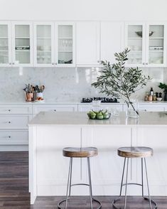 Beautiful NSW family farmhouse dating back to the : Tractor stools from Freedom sit under the island bench, which features a Talostone Carrara Gioia benchtop. Kitchen cabinetry is by Stuart Peart of Castlereagh Cabinets*Photography: Abbie Melle* Farmhouse Style Kitchen, Modern Farmhouse Kitchens, Rustic Kitchen, New Kitchen, Home Kitchens, Kitchen Ideas, Awesome Kitchen, Country Kitchens, Farmhouse Cabinets
