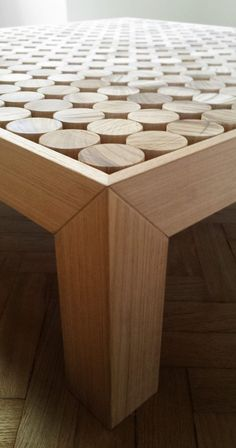"""This table was created with """"suspended"""" solid teka wood cylinders. The dimensions of the table can be customizedat the customer's request. The series is completed with two models of nighstands and abathroom bench."""