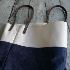 Image of handcarry 5 denim with plaster leather band (made to order)