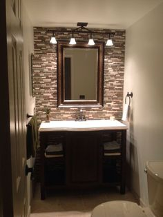 Lighting idea for main floor bathroom.