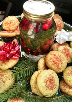 Sugar cookies and a floating cranberry candle.