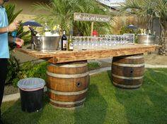 rustic wedding bar, isn't this awesome! Instead of barrels two logs since it is an Alaskan wedding