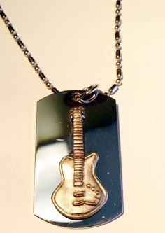 Musical Instrument Music Guitar Pewter Emblem Logo Symbols - Military Dog Tag Luggage Tag Key Chain Metal Chain Necklace - The dog tag is made of stainless steel with 3D PEWTER METAL EMBLEM design as shown. The dog tag is 2″ x 1.1″ in size and can be engraved on the backside (sorry, we do not offer an engraving service).  This item also includes a 36″ metal chain with a clasp. Also, this can be... - http://ehowsuperstore.com/bestbrandsales/musical-instrument