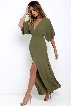 Where the Wind Blows Olive Green Maxi Dress at Lulus.com!  |  Take a joy-filled jaunt on a breezy day with the Where the Wind Blows Olive Green Maxi Dress! Textured woven poly shapes this casual maxi dress with wide-cut, short sleeves and a V-neckline. High waistline (with tying sash) transitions into a billowing maxi skirt with thigh-high side slit. Hidden back zipper with clasp.