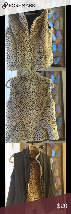 """😕RE-POSH!  Reversible faux leopard/black vest ✳️   REVERSIBLE!  Faux leopard print & black - EUC ✳️  Zip closer - 2 slit pockets each side ✳️  Center back to hem ~22.5"""" ✳️  Seam to seam underarm, ~18.5"""" ✳️  Arm hole ~8"""" ✳️  Machine wash cold - polyester blend ✳️  This is fabulous - sadly, I bought it having been told it was Med but it is actually a Small ✳️  Perfect for moving into Fall! Thank you for looking - Plz ask if questions East 5th Jackets & Coats Vests"""