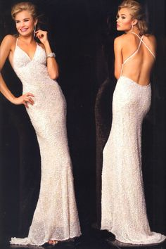 Long Silk Evening Dresses by SCALA Designs<BR>47542<BR>Long silk dress with thin crisscross straps, floral sequined and beaded motif
