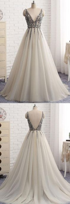 light gray tulle v-neck long tulle sequin top of the gown.
