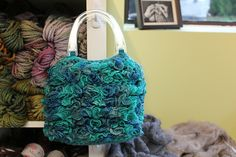 Offering more than enough room to hold all of life's everyday important stuff, this fun ruffled tote knits up quickly and easily using just a single skein of Frill Seeker yarn. Finished dimensions approximately: Ruffle Yarn Projects, Knitting Projects, Crochet Projects, Crochet Ideas, Lace Knitting Patterns, Loom Knitting, Free Knitting, Crochet Purses, Crochet Bags