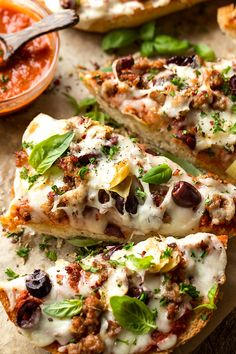 "French bread pizza goes ""gourmet"" with spicy Italian sausage, Kalamata olives and artichoke, plus the added option of a quick and zesty homemade pizza sauce!"