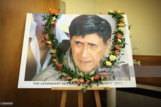 An image depicting Bollywood actor Dev Anand is displayed in the chapel at Putney Vale Crematorium on December 10, 2011 in London, England. Friends and family came to pay their respects to the legendary Actor who died of a heart attack aged 88 in London. Mr Anand produced and acted in many films including Guide, Paying Guest and Jewel Thief, and won the Dada Saheb Phalke award, Indian cinemas top honour in 2002.