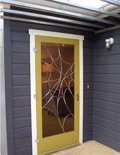 Green screen door by metal artisan Susan Wallace
