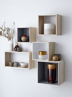 Wooden shelves and seventies vases. ©Bloomingville