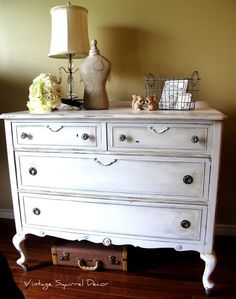 Antique Dresser painted in Pure White Annie Sloan Chalk Paint.  Accented with silver gilding, lightly distressed, crackled and dark wax highlighted.