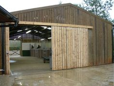 Steel frame and timber boarding internal stables.#stables