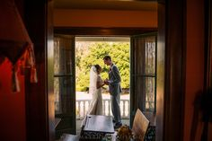 Photo of the happy couple on the balcony of the historic Kellogg House at the Heritage Museum of Orange County  -  Photo by Matthew Saville