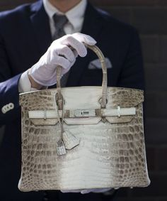 ba78d5f89336 The Hermes diamond and Himalayan nilo crocodile Birkin handbag. It s a  steal .