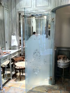 Bent glass shower door with etching. #Frenchbaths,#luxuryhomes