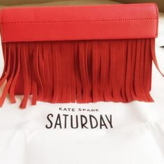 Kate Spade Saturday Fringe Red Clutch Beautiful red leather clutch with matching red suede fringe and magnetic top closure.  Lined with signature fabric and has an interior slip pocket.  Also has an outer back card slot.  Comes with the dust bag.  Brand new with tags! kate spade Bags Clutches & Wristlets