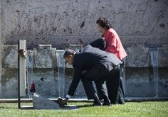 US President Barack Obama lays a rose at the grave of Cesar Chavez with his widow Helen F. Chavez during a tour of a memorial garden at the Chavez National Monument October 8, 2012 in Keene, California. Obama visited the memorial which honors Cesar E. Chavez, an American civil rights activist and labor leader, who helped found the National Farm Workers Association and died in 1993 while also campaigning in California.  AFP PHOTO/Brendan SMIALOWSKIBRENDAN SMIALOWSKI/AFP/GettyImages Photo…