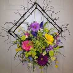 Spring wreath with a twist. For more information email: thegiftcorner1@hotmail.com