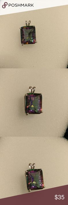 Mystic Topaz Pendant in Sterling Silver Handmade Sparkling Topaz Pendant in Sterling Silver Handmade. This Stunning Stone Catches Every Color of the Rainbow! Handmade by a jeweler friend of mine. Fancy Emerald Cut. You have to see the Fire Colors and Sparkle with your own eyes! This piece won't disappoint! Jewelry Necklaces