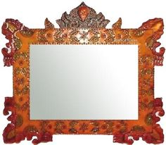 Hand crafted colonial style tin mirror from San Miguel de Allende. The frame is painted in orange and dark red color. #rusticahouse #myrustifca #tinmirror