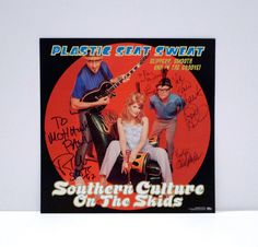 Southern Culture On the Skids - Vintage Autographed / Personalized Record Store Display Flat / Poster - 1990s  Plastic Seat Sweat -- Slippery, Smooth and in the Groove!  Measurements: 12 by 12 inches -- two sided  Tags/marks/Id: Geffen Records , Photograph by Ron Keith   In very good condition, very minor signs of being handled when autographed -- looks close to new. Personalized to Paul Mohawk. One owner.  Known affectionately as SCOTS by their fans, they mix rockabilly, surf rock, country…