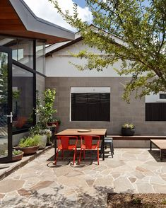 A patio at the front of this home in Melbourne acts as an outdoor living room for the family that lives there. Front Courtyard, Courtyard House, Outdoor Spaces, Outdoor Living, Outdoor Decor, Concrete Block Walls, Melbourne House, Rustic Design, The Great Outdoors