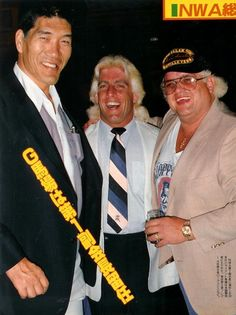 "Three great NWA champions together at the National Wrestling Alliance convention in 1985. Shohei ""Giant"" Baba (3 time NWA champion), ""Nature Boy"" Ric Flair (depends on how you count them, 8 NWA world championships, as many as 21 world titles all together), and ""The American Dream"" Dusty Rhodes (3 time NWA champ)."