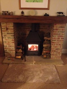 Log burner and brick surround. Wood Burner Fireplace, Fireplace Hearth, Fireplace Design, Fireplace Ideas, Exposed Brick Fireplaces, Rustic Fireplaces, Country Fireplace, Cottage Fireplace, Paint Colors For Living Room