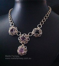 Maille Fantasy Gallery. www.maillefantasy.com.au `I LOVE Fluorite, and I Love how these octahedrons are wrapped, I wish I knew what weave it is.