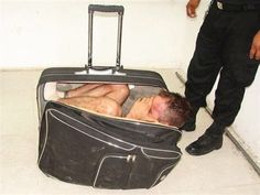 Juan Ramirez Tijerina photographed curled inside a suitcase after he tried to escape from prison in Chetumal, Mexico.