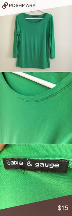 Lucky Green Quarter Length T-Shirt This soft, lightweight shirt is sure to bring out the color of your eyes! Flattering with a pair of jeans or tucked into a skirt, this shirt should be yours. Cable & Gauge Tops Tees - Long Sleeve