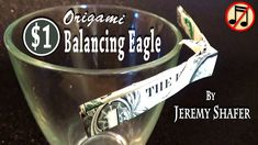 """[Low Intermediate] How to fold a dollar bill into an eagle that balances by its beak on the tip of a pyramid or on the rim of a glass. I put """"Easy"""" in the ti..."""