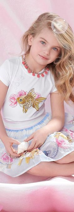 MONNALISA BIMBA Girls White Gold Fish Diamanté T-Shirt Blue Floral Skirt for Spring Summer 2018. A beautiful golden diamanté fish is the eye-catching motif at the centre of this luxuriously soft t-shirt by Monnalisa Bimba. #girlsclothing #kidsfashion #fashionkids #girlsdresses #childrensclothing #girlsclothes #girlsfashion #monnalisa