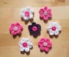 Marianna's Small Knitted Summer Flowers These pretty little . Marianna's Small Knitted Summer Flowers These pretty little flowers are so quick and easy to knit. Knitted Flowers Free, Knitted Flower Pattern, Baby Cardigan Knitting Pattern Free, Baby Hats Knitting, Knitting Patterns Free, Free Knitting, Crochet Patterns, Crochet 101, Knitting Stiches