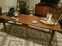 Mid-century wooden coffee table with white + grey aztec rug.  Thrift Store Hits || Champagne + Linen