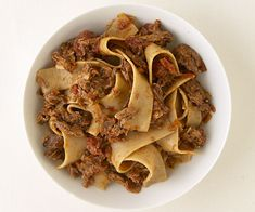 Pappardelle with Venetian Duck Ragu recipe - Venetian ragù, is made from the meat of the wild ducks and is perfumed with native bay leaf and fresh sage. This recipe gets deep flavor from duck legs and thighs and dry red wine. Venetian duck ragù is typically served with fat, tubular buckwheat noodles called bigoli, but it's also delicious with whole-wheat fettuccine, spaghetti, or pappardelle, as shown here.