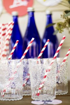 Clear glasses, red and white striped straws, and Saratoga spring water.