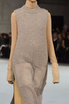 Biscuit beige knitted dress and camel trousers, close up detail, by Edun F/W 2014