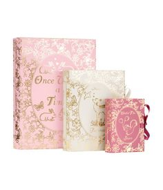 £14.99 Storage boxes in cardboard with a gold-coloured print shaped like books that fasten with a ribbon. Different sizes that fit inside each other. Sizes: Large 17.5x23 cm, Medium 12.5x16 cm, Small 7.5x10 cm.