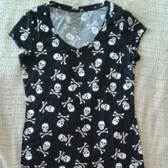 Skull & Crossbones V-neck Shirt Black shirt with cute skull & crossbones allover print. Size L but kinda small so would also fit medium. Not very stretchy, would not recommend for bustier babes.  ***Bundle 2+ items for 30% off, 5+ for 40% off or make me a reasonable offer on any single item! No Boundaries Tops Tees - Short Sleeve