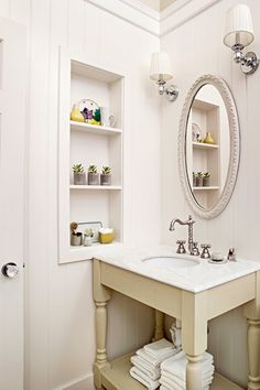 We love the DIY vanity, cut-in shelving and beadboard siding in this reader's master bath redo. | Photo: Lisa Romerein | thisoldhouse.com
