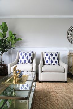 Creating a formal living room. I love these chairs from West Elm.