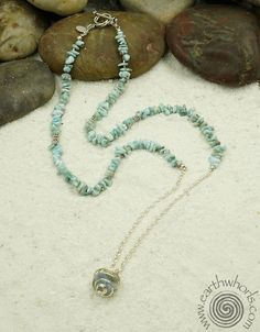 """http://earthwhorls.com/products/1731sn  Aquamarine & Hawaiian """"Good Luck Basket"""" charm necklace - put a little fun in your summer fashion with a one of a kind, handmade, natural stone & sterling silver design from EarthWhorls.  Free shipping!"""