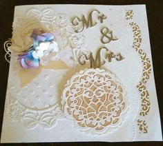 Faux inlayed wedding  Various cherry lynn design dies and spellbinders border die. Stampin up and distress inks lindys stamp gang moon shadow mist pan pastels white pearl medium (fine). 80# white card stock, gold vellum, ellen hutson craft a board, pewter embbossing folder.