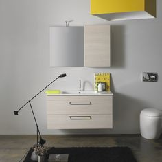 Icaro suspended cabinet with large drawers and ceramic washbasin W106xD50xH57.